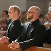 Matthew Donovan and Eric Immel share a quiet moment while preparing to receive the Eucharist at the First Vows ceremony on August 10, 2013, in St. Paul, Minnesota, at St. Thomas More Parish.