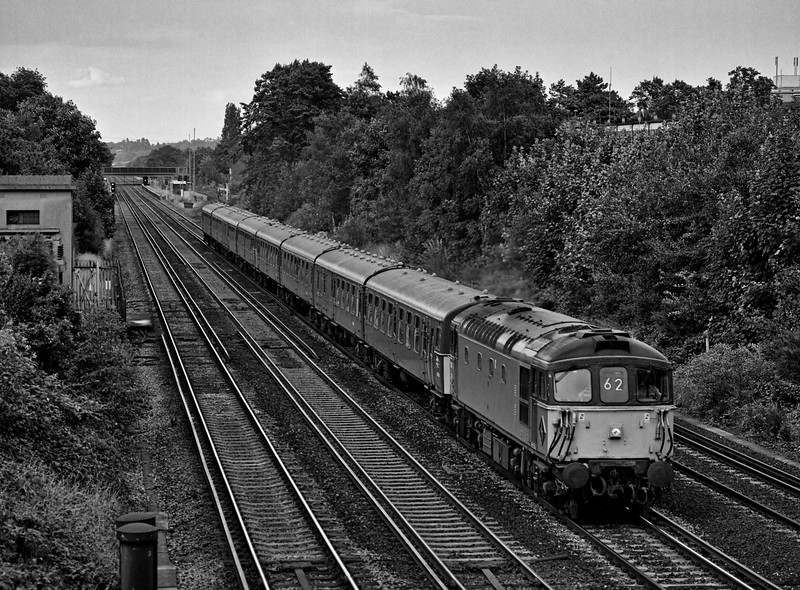 33116 with TC units, 417 and 410, at West Byfleet with 1Z13, the 17:34 Waterloo - Basingstoke, on 10th July 1993. This was running as a relief service to the following 17:45 Waterloo - Yeovil Junction, which was the very last loco-hauled service on the Waterloo - Exeter route. Scanned negative.