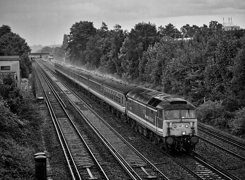 47702 at West Byfleet with the 17:45 Waterloo - Yeovil Junction on Saturday 10th July 1993. <br /> This was the very last loco-hauled service on the Waterloo - Exeter route. Scanned negative.