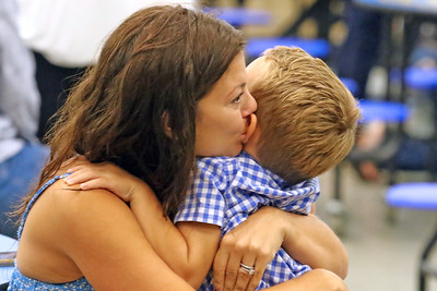 "Kelli Fahey (left_ shares a moment with her son Connor as Spring Lake Heights Elementary school hosted their ""Boohoo and Yahoo"" kindergarten breakfast for new students and their parents on the first day of school on Wednesday Sept.4, 2019  (MARK R. SULLIVAN THE COAST STAR)"