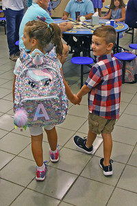 "Friends Avery Clark and Liam Bloodgood hold hands as they head to their classroom as Spring Lake Heights Elementary school hosted their ""Boohoo and Yahoo"" kindergarten breakfast for new students and their parents on the first day of school on Wednesday Sept.4, 2019  (MARK R. SULLIVAN THE COAST STAR)"
