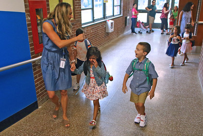 "Teachers lead students to their classrooms as Spring Lake Heights Elementary school hosted their ""Boohoo and Yahoo"" kindergarten breakfast for new students and their parents on the first day of school on Wednesday Sept.4, 2019  (MARK R. SULLIVAN THE COAST STAR)"