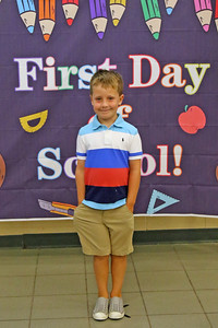 """John Dugan poses for a photo before heading to class as Spring Lake Heights Elementary school hosted their """"Boohoo and Yahoo"""" kindergarten breakfast for new students and their parents on the first day of school on Wednesday Sept.4, 2019  (MARK R. SULLIVAN THE COAST STAR)"""