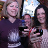 The River Styx Brewing Company held a first keg opening at Partners Pub in Fitchburg on Thursday night. Getting ready to try the stout Croneus Lord of Time at the event is Amy Bonilla of Fitchburg and her friend Kim Curry of Gardner. Just behind them is owner of the company Jackie Cullen. SENTINEL & ENTERPRISE/JOHN LOVE