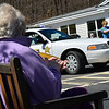 KRISTOPHER RADDER — BRATTLEBORO REFORMER<br /> Sandy Dowley, a resident of Valley Cares, in Townshend, Vt., smiles as a parade made up of first responders goes by to raise the spirits of those staying there during the COVID-19 pandemic on Tuesday, April 28, 2020.