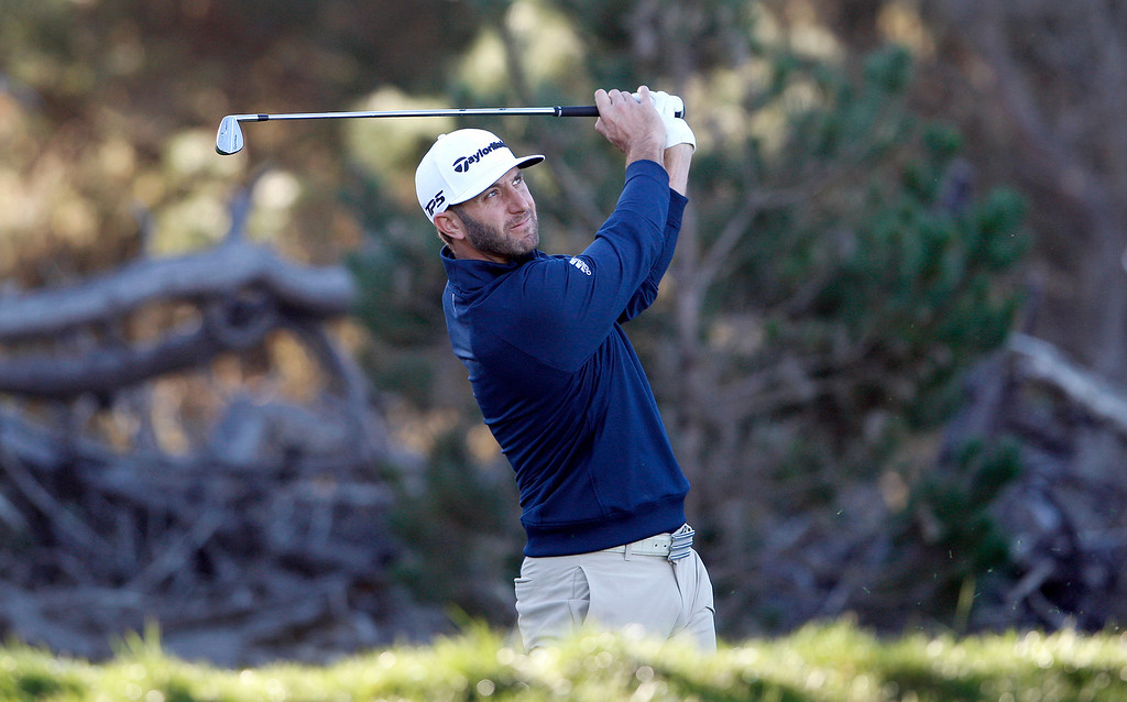 . Dustin Johnson tees off on the third hole Spyglass Hill Golf Course during the first round of the AT&T Pebble Beach Pro-Am on Thursday, Feb. 8, 2018.  (Vern Fisher - Monterey Herald)