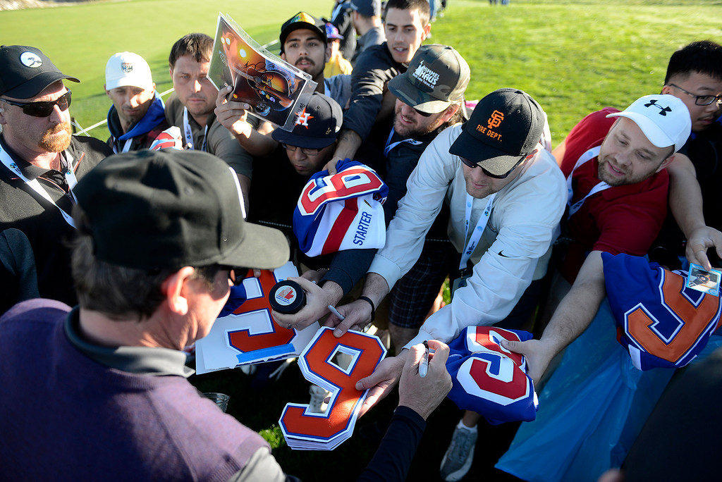 . Former hockey great Wayne Gretzky gets surronded by autograph seekers at Spyglass Hill Golf Course during the first round of the AT&T Pebble Beach Pro-Am on Thursday, Feb. 8, 2018.  (Vern Fisher - Monterey Herald)