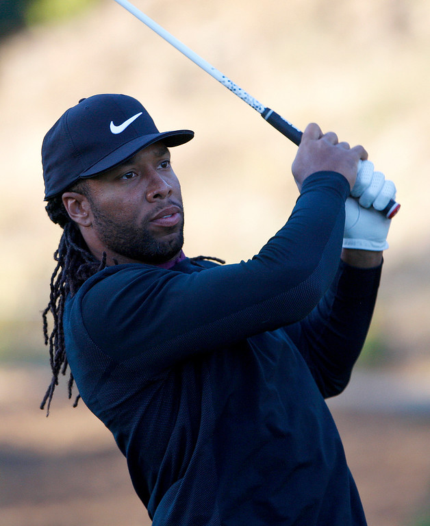 . Larry Fitzgerald of the Arizona Cardinals watches his second shot while playing on the first hole at Spyglass Hill Golf Course during the first round of the AT&T Pebble Beach Pro-Am on Thursday, Feb. 8, 2018.  (Vern Fisher - Monterey Herald)