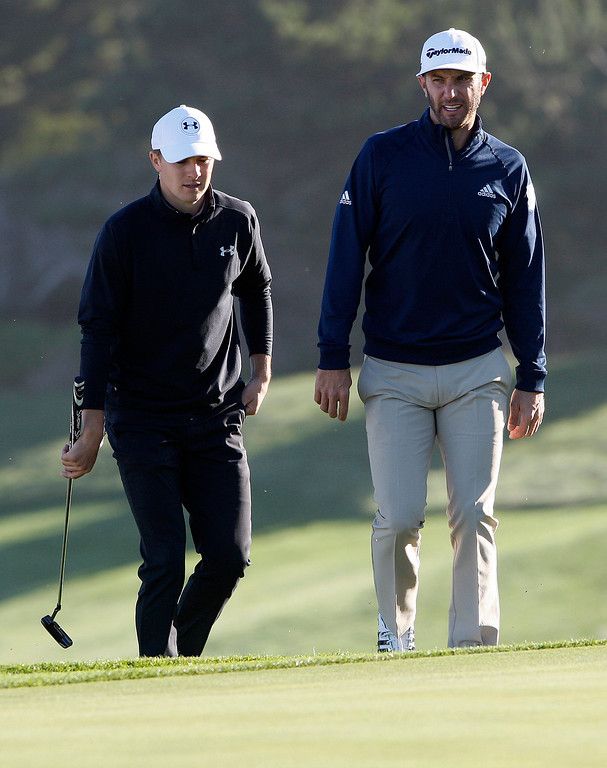 . Jordan Spieth and Dustin Johnson play the second hole at Spyglass Hill Golf Course during the first round of the AT&T Pebble Beach Pro-Am on Thursday, Feb. 8, 2018.  (Vern Fisher - Monterey Herald)