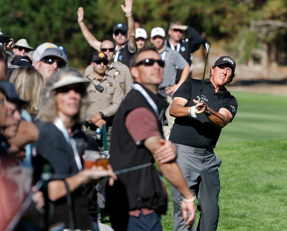 . Phil Mickelson hits his second shot close the gallery on the sixth hole at Spyglass Hill Golf Course during the first round of the AT&T Pebble Beach Pro-Am on Thursday, Feb. 8, 2018.  (Vern Fisher - Monterey Herald)