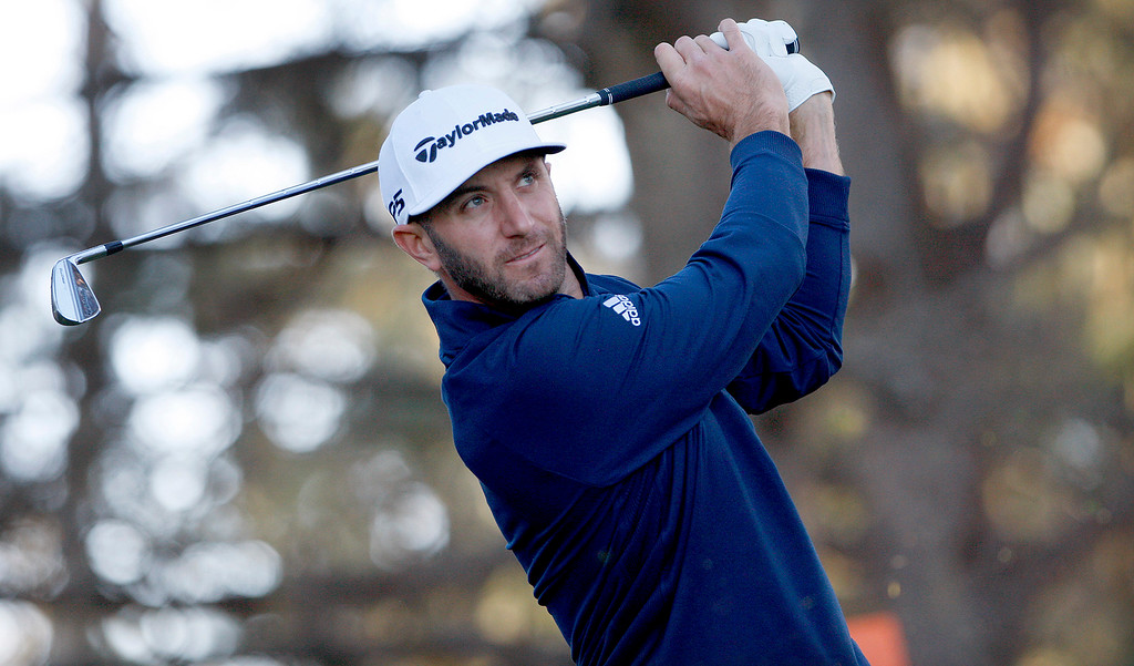 . Dustin Johnson tees off on the second hole Spyglass Hill Golf Course during the first round of the AT&T Pebble Beach Pro-Am on Thursday, Feb. 8, 2018.  (Vern Fisher - Monterey Herald)