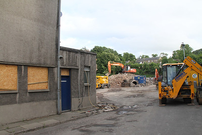 Linlithgow depot bites the dust - literally! Just after this I found myself explaining to a couple who had just left the Four Marys what we were about, and was rewarded with a sympathy cuddle by the lady who took my upset at seeing the depot demolished in very good faith!