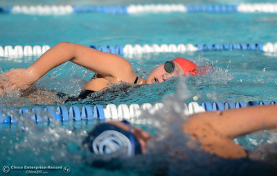 Chico's Sienna Cross, top, and Pleasant Valley's Caroline Lacey pass each other swimming freestyle as Chico and Pleasant Valley compete Wednesday in the Fish Bowl at In Motion Fitness in Chico. (Will Denner -- Enterprise-Record)