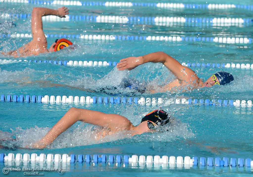 . Pleasant Valley\'s Charlie Surminsky leads the 200 freestyle with Chico\'s Zack O\'Connor close behind during the annual Fish Bowl dual meet between Chico and Pleasant Valley swim teams Wednesday October 4, 2017 at In Motion Fitness in Chico, California. (Emily Bertolino -- Enterprise-Record)