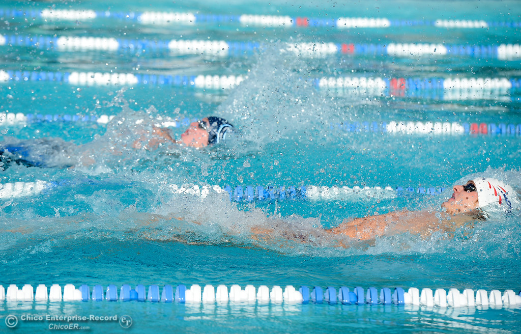 . Chico High\'s Liam Davis leads off the boys 200 medley relay with Pleasant Valley\'s Gabe Bettner close behind during the annual Fish Bowl dual meet between Chico and Pleasant Valley swim teams Wednesday October 4, 2017 at In Motion Fitness in Chico, California. (Emily Bertolino -- Enterprise-Record)