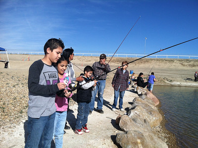 Kids and families enjoying Free Fishing Day at Carbon County Pond. Photo taken 6-7-14 by Brent Stettler, Utah Division of Wildlife Resources.