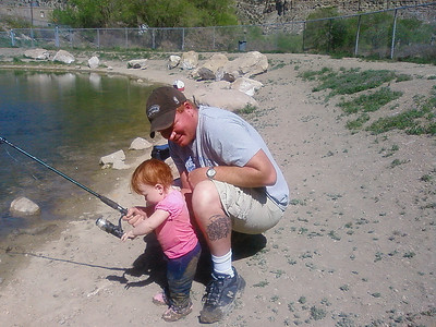Geff Bryan and two-year-old Rachael Bryan fish at the Gigliotti Pond in Helper.