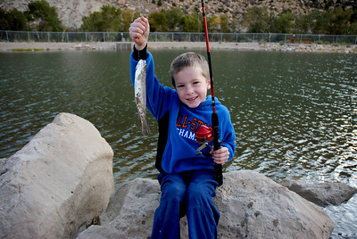 Austin Wyatt (6) of Helper shows trout caught at the Gigliotti Pond in Helper.  By Brent Stettler on 9-22-07