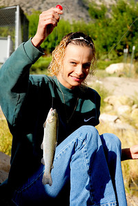 Crystal Hayes of Price fishes at the Gigliotti Pond in Helper.  By Brent Stettler, Utah Division of Wildlife Resources. 9-25-07