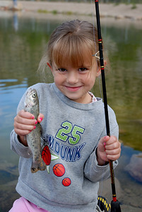 4 year old Katie Jones (4) fishes at the Gigliotti Pond in Helper.  By Brent Stettler, Utah Division of Wildlife Resources on 9-22-07.