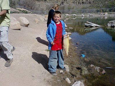 Zachariah Zobell of Springville with his 5 lb. 13 oz. albino rainbow trout, taken from the Gigliotti Pond in Helper. By Randall Stilson, Utah Division of Wildlife Resources on 5-4-08