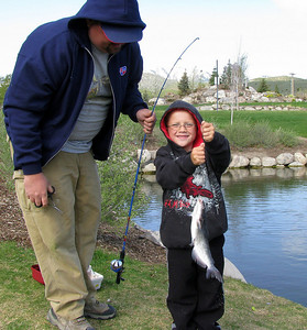 This young angler shows the catfish he caught at The Cove, a community fishing water in Herriman.  File photo taken 5-11-08, courtesy of the Utah Division of Wildlife Resources.