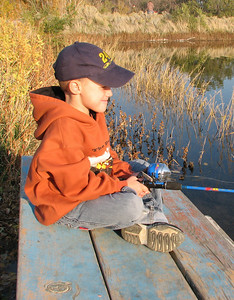 A young boy eagerly awaits a bite while fishing at Mayor's Pond in Brigham City.  File photo taken 10-28-07, courtesy of the Division of Wildlife Resources.