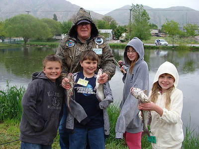 Members of Brigham CityÕs youth fishing club show the catfish their adult mentor helped them catch.  File photo courtesy of the Utah Division of Wildlife Resources