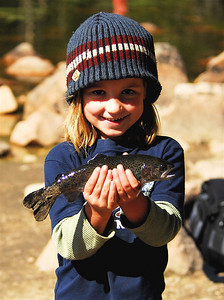 Smiles like this await those who sign up to help Utah's youth fishing clubs.   photo taken 7-15-05, courtesy of the Division of Wildlife Resources.