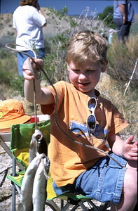 Little boy fishes at Gigliotti Pond in Helper, Utah