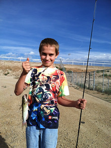 Dillon Asay of Price with a catfish caught during a Carbon County  family fishing event. Photo taken 8-10-13 by Brent Stettler.