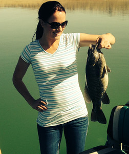 Anna Grover with a big smallmouth bass out of Flaming Gorge. Photo taken 05-14. Courtesy of Ryan Mosley.