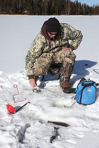 Ice fishing in the Uintas in early winter provides fast fishing, beautiful scenery and solitude. Anglers can also keep a bonus limit of four additional brook trout when fishing the Uintas. Photo by Phil Douglass