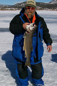 Ron Sorensen shows off his splake caught at Joe's Valley Reservoir on January 4, 2009.  All the splake caught measured between 25 and 27.5 inches and their weights were estimated to range from 5 to 8 pound.  Tube jigs tipped with chub meat was used and he fished in 15 to 25 feet of water just off the bottom.  At the time, the ice was only 2.5 inches thick.