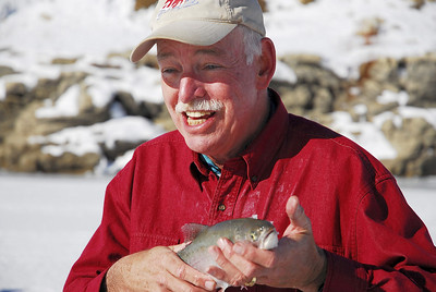 Reece Stein shows off the rainbow trout he caught ice fishing at Scofield Reservoir on 12-8-06. Photo by Brent Stettler, Utah Division of Wildlife Resources.