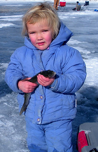 4-year-old Kira Paskett of Ferron caught this splake at Joes Valley Reservoir on January 17, 2009.  Photo by Randall Stilson, Utah Division of Wildlife Resources.