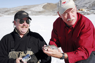 Danny Eliason (L) and Reece Stein (R) pose with fish caught through ice on 12-8-06. Photo by Brent Stettler, Utah Division of Wildlife Resources