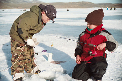 Two boys ice fishing at Scofield Reservoir