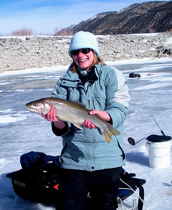 Alley Foutz, 17, of Salt Lake City shows off 3.5 lb., 21-inch splake caught by her step dad, Craig Walker at Joes Valley Reservoir on January 17, 2009.  Photo by Randall Stilson, Utah Division of Wildlife Resources