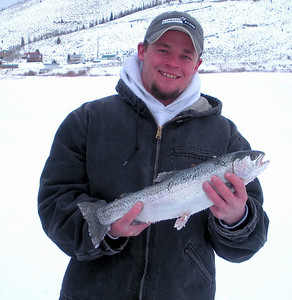 "Isaac Eranbrack of Heber, Utah caught this 3-lb. rainbow trout at Scofield Reservoir on 1-2-09 using a ""Trout Magnet"" jig, tipped with a meal worm.  Photo by Randall Stilson, Utah Division of Wildlife Resources."