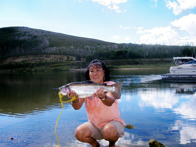 Su Jones with a 5-lb. rainbow taken from the dock at Scofield Reservoir's Mountain View unit.