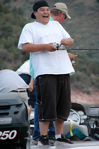 Hunter Maldonado, a winner in the 2006 Utah Conservation Officer's Association essay contest, seems to be having a good time as he reels in a hefty trout at Flaming Gorge Reservoir.