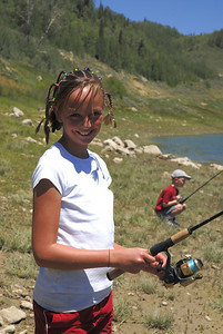 Celine Christensen (10) of Salem poses with rod at Miller Flat Reservoir on 7-4-07.  Photo by Brent Stettler, Utah Division of Wildlife Resources.