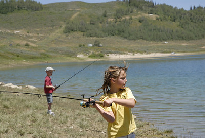 Rachel Christensen, 8, from Salem casts her line into Miller Flat Reservoir on 7-4-07.  Photo by Brent Stettler, Utah Division of Wildlife Resources
