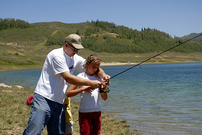 Blake Christensen helps his daughter, Celine (10), with her fishing pole at Miller Flat Reservoir on 7-4-07.  Photo by Brent Stettler, Utah Division of Wildlife Resources