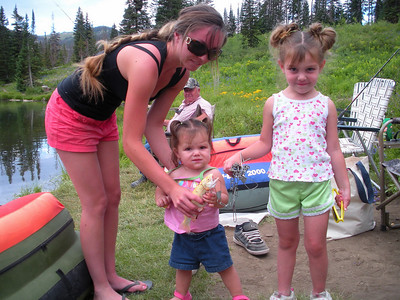 One-year-old Zaycie Taylor holds an albino trout she caught with Mom's help.  They fished at Potter's Ponds on the Manti-LaSal National Forest over the Pioneer holiday weekend.  Zaycie's sister had to get in the picture and stands beside her.