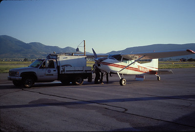 Loading a plane with fingerling for aerial stocking of high mountain lakes.  Photo by Utah Division of Wildlife Resources