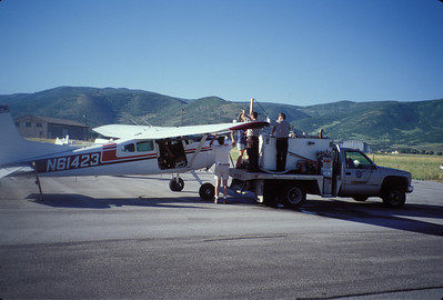 Airplane being loaded with fingerling for being stocked into a high mountain lake.  Photo by Utah Division of Wildlife Resources.