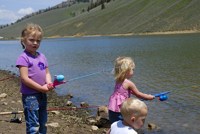 Brantley (Left ,5) and Taylor (Right, 3) Johnson fish at Electric Lake while little brother Braden (Foreground, 1) plays.  By Brent Stettler, Utah Division of Wildlife Resources, summer 2007.