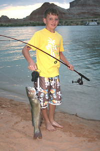 Eleven -year-old Clint Gates caught this 7 lb. catfish in Warm Springs (Lake Powell) July 14, 2008.  It was early evening and he was using shrimp bait casting off the houseboat next to the shore.  By Utah Division of Wildlife Resources